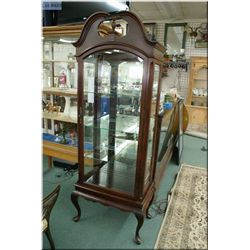 Solid mahogany single door illuminated curio cabinet made by Gibbard