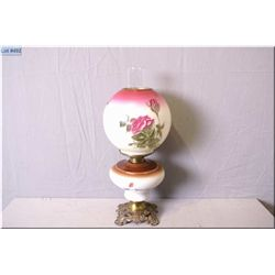 Antique banquet lamp with cast base and hand painted bowl and globe