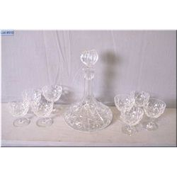 Crystal ship's decanter with six matching crystal glasses and two taller glasses