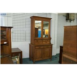 Antique chest on chest cabinet with crown topper, two raised panel lower doors, two mirrored upper d