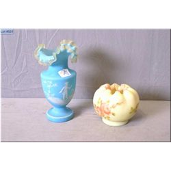 An antique blue cased ruffled edge Mary Gregory vase and a Fenton glass dish with hand painted flowe