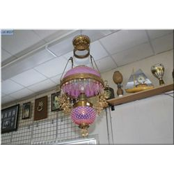 Antique hanging oil lamp with milk to lilac hobnail bowl and shade, hanging lustres and cast leaf an