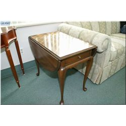 Modern single drawer drop leaf occasional table on cabriole supports