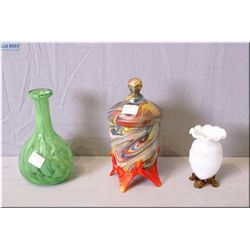 Three pieces of vintage glass including an end of day glass lidded pot with applied amberina feet, a