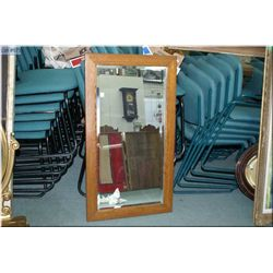 """Oak framed bevelled wall mirror. Overall dimensions 41"""" by 24"""""""