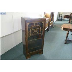 A single door Art Deco curio cabinet