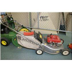 A Honda rear bag lawn mower, Model HRA 215