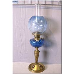 Antique oil on Nouveau influenced metal base with blue glass bowl and etched globe with clear hurric