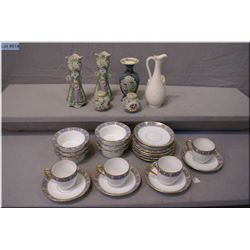 A selection of collectibles including Limoges porcelain demitasses and dishes, moriage salt and pepp