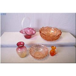 A selection of vintage and collectible glass including cranberry glass basket with clear handle and