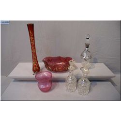 A selection of vintage and collectible glass including decanters, ruby glass and gold overlay vase e