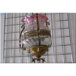 Antique hanging fixture with a clear to lilac glass shade in brass galley