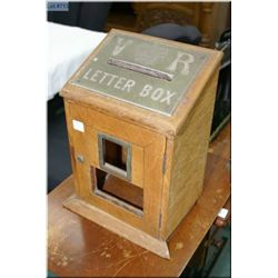 An antique oak letter box with brass plate