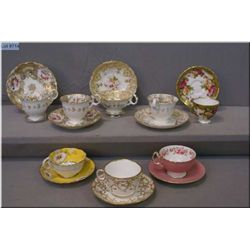 Selection of collectible tea cups and saucers including Royal Chelsey, Ainsley, Royal Albert, etc
