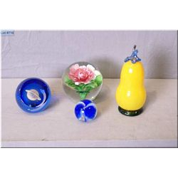 Three glass paperweights including a limited edition Caithness plus an art glass fruit