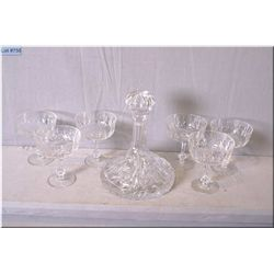 Crystal ship's decanter and six crystal champagne glasses