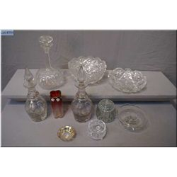 A selection of vintage and collectible glass including decanters, heavy crystal bowl, glass bud vase