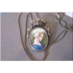 A hand painted cameo of a young woman in 800 silver on a sterling silver chain