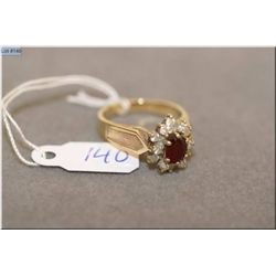 Lady's 14kt yellow gold, ruby and diamond cluster dinner ring set with 0.63ct natural ruby and accen