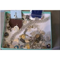 Lady's sterling silver charm bracelet and a large selection of loose silver charms
