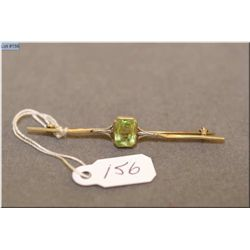 Lady's antique 10kt gold and peridot pin