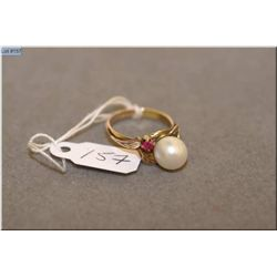 Lady's 14kt yellow gold, pearl and ruby ring