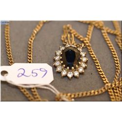 Lady's 10kt yellow gold sapphire and diamond pendant set with 2.48ct oval shaped sapphire and 0.45ct