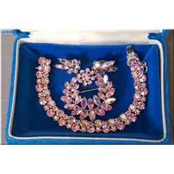 Lady's signed Sherman pink crystal bracelet, earring and matching brooch