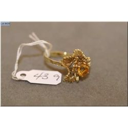 Lady's 9ct yellow gold floral designed ring set with single gemstone