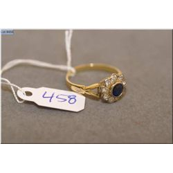 Lady's 18kt yellow gold, sapphire and diamond ring set with 0.27ct natural blue sapphire and nine ol