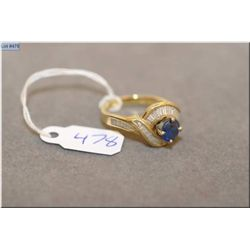 Lady's 18kt yellow gold, sapphire and diamond ring set with 0.91ct oval shaped natural sapphire and