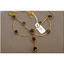 Lady's 18kt yellow gold custom made sapphire necklace set with 8.00ct of oval shaped and mixed cut n