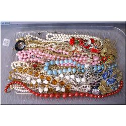 A selection of vintage and collectible costume jewellery including beaded necklaces, brooches, pins