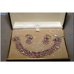 Signed Sherman bracelet and earrings set with pink stones, note missing and loose stone