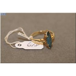 Lady's vintage 10kt yellow gold ring set with marquise cut gemstone
