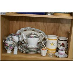 A selection of vintage collectibles including Paragon tea set, Saddler Pottery graduating jugs, Rose
