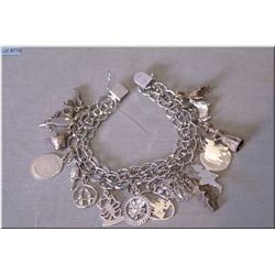 a vintage sterling silver charm bracelet and charms