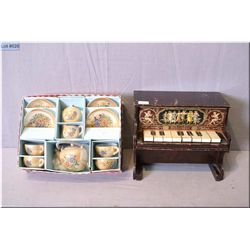A vintage Schoenhut toy piano and a Japanese boxed lustreware child's tea service
