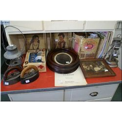 A selection of collectibles including sad irons with handles, vintage framed pictures, cake decorato