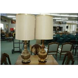 A matched pair of gold table lamps