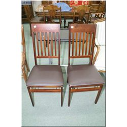 Two modern folding chairs and a tilting chair side tray with castors