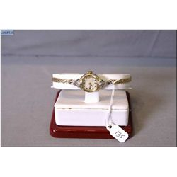 Lady's 14kt yellow gold cased watch set with diamonds