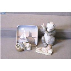 Three Lladro figures including panda bear, duck family, sleeping child and a Denmark dish