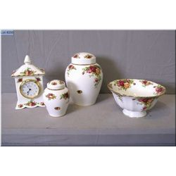 "Four pieces of Royal Albert ""Old Country Roses"" including two ginger jars, mantle clock and a low co"