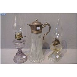 Two pressed glass Canadiana oil lamps and a carafe