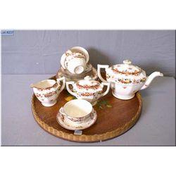 A Japanese made tea service including teapot, lidded sugar and cream plus four tea cups and six sauc