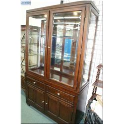 Modern chest on chest two door display cabinet with under storage, bevelled panels and illumination