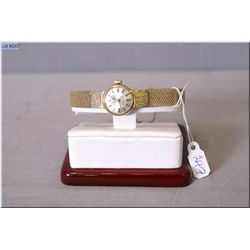 "Lady's 14kt gold cased ""Sterna-Matic, Gold Heart"" watch with second hand and gold bracelet, working"
