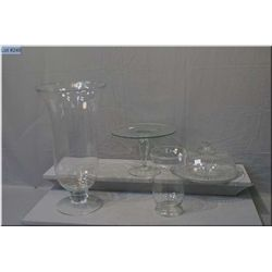 A large clear decorator vase, smaller vase/hurricane, glass cake pedestal and a domed cake plate