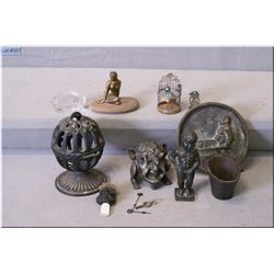 Selection of collectibles including bronze plate, sculpture of a little boy peeing, gargoyle motif l